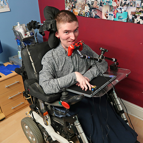 Chad in a wheelchair smiling