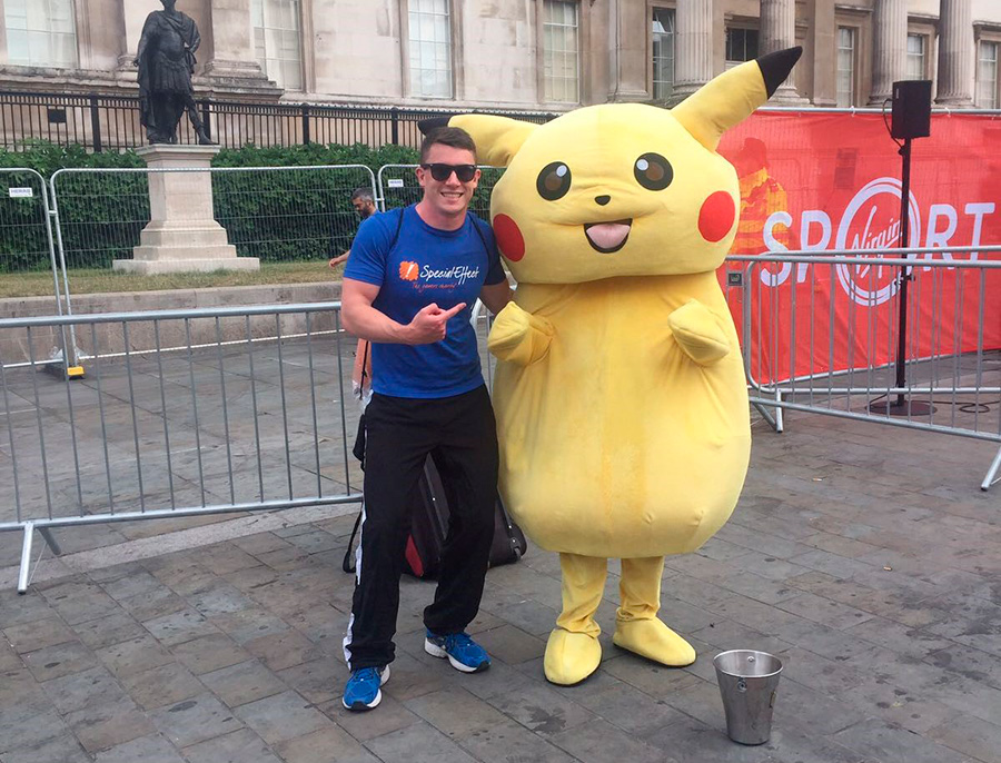 Nick next to large Pikachu