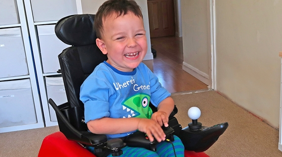 Small boy in wheelchair playing games
