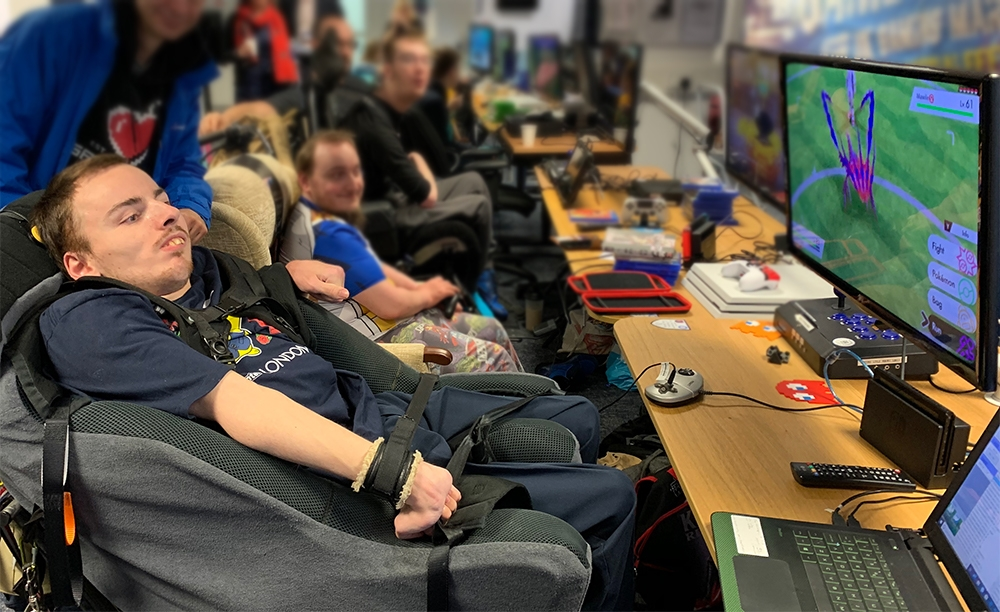 Young man in wheelchair playing a video game