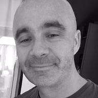 A bald man smiling